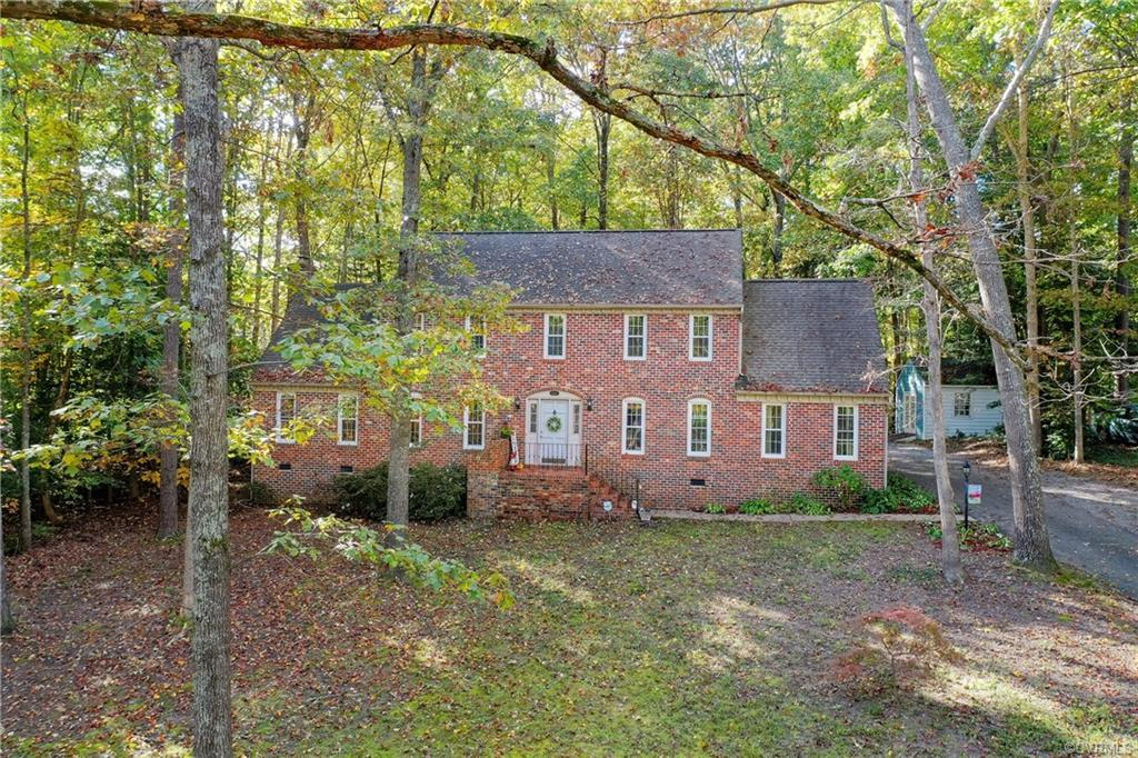 Welcome home to this stunning brick front Colonial home in Chesterfield!   Beautifully updated throughout!   Traditional floor plan with all of the space you need to live and entertain.   So many exciting features including formal rooms, bright and airy sunroom with skylights, spacious family room with white washed brick accent wall and wood burning fireplace.    Gorgeous kitchen that anchors the home!   Granite tops, custom cabinetry including an island with seating.   Tile backsplash, bay window, stainless appliances including a wine chiller.    Upstairs are 4 large bedrooms, 2 full baths, and a walk up attic.   Primary bedroom was remodeled to include a huge (11x13) custom built walk in closet, ethanol burning f/p on brick wall, and a beautiful bathroom.   Other notable features:   Double width paved driveway, detached storage shed,  huge deck (2015), HVAC replaced in 2014, kitchen remodeled in 2014, hot water heater 2017, 1 1/2 car attached garage, walk up attic with flooring, tile flooring in bathrooms, all bathrooms updated, eat in kitchen, new plumbing and electrical fixtures throughout, pantry, laundry room, and over half acre cul de sac lot.  Community pool and amenities.