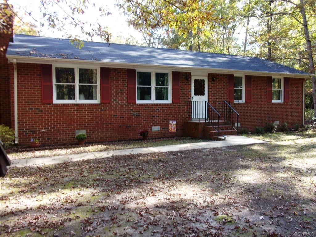 Beautiful & well maintained brick Rancher nestled on 5 acres of land in Eastern Henrico!!  This is a