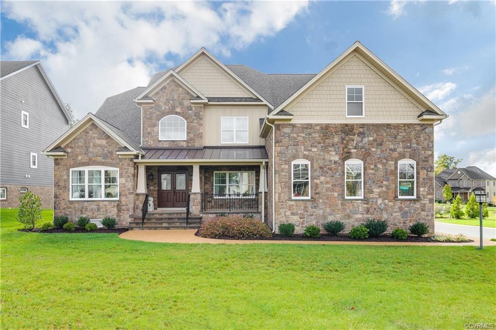 Beautiful one year old home sitting on a large lot in the highly desirable Grey Oaks Estates! First
