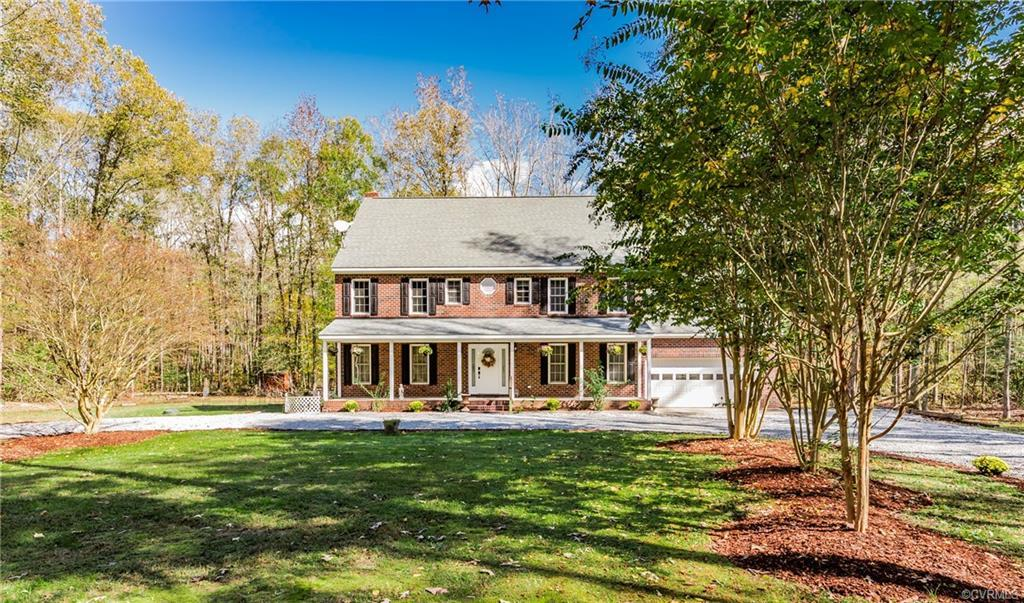 Beautiful Custom Brick home on 5.8 private acres with a babbling stream in Powhatan County. Located