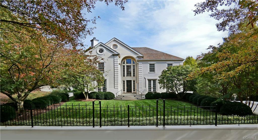 Beautiful, timeless home set on an exquisitely landscaped 1+ acre lot with community river access in