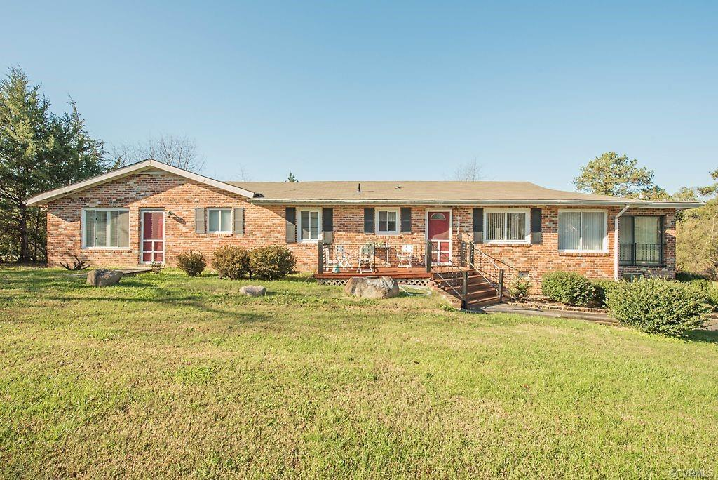 4 bedroom, 3 bathroom;  One-Story, brick home on 1.5 Acres in Manakin-Sabot!  This home is a perfect