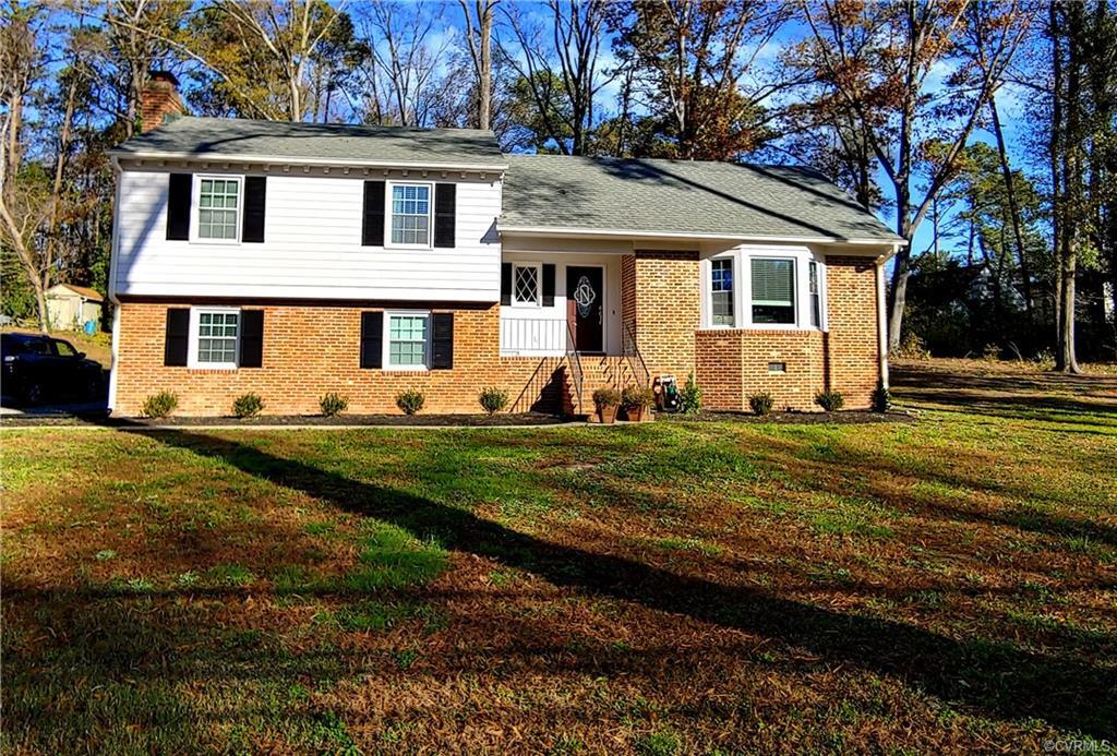 LIKE NEW & MOVE-IN READY!!! Spacious Tri-level on a 1 acre lot backs to wooded area & has 4 bedrooms