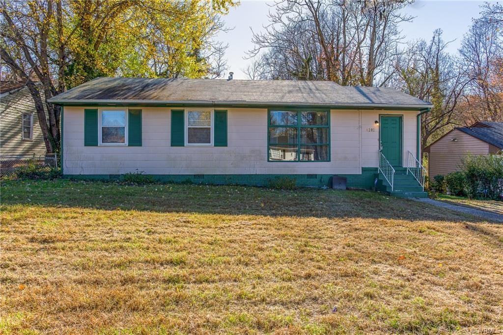 Great starter home or rental at this low price.  With 3 bedrooms and central air.  The picture windo