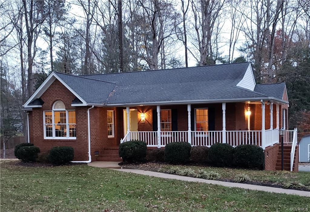Enjoy the feel of community without the HOA at this beautiful custom built all brick rancher located