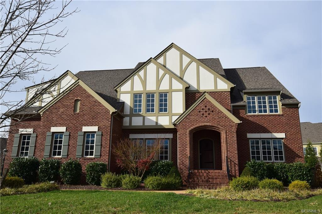 Luxury Tudor Toddbury home located in the Ellington Woods section of Wyndham, features brick on thre
