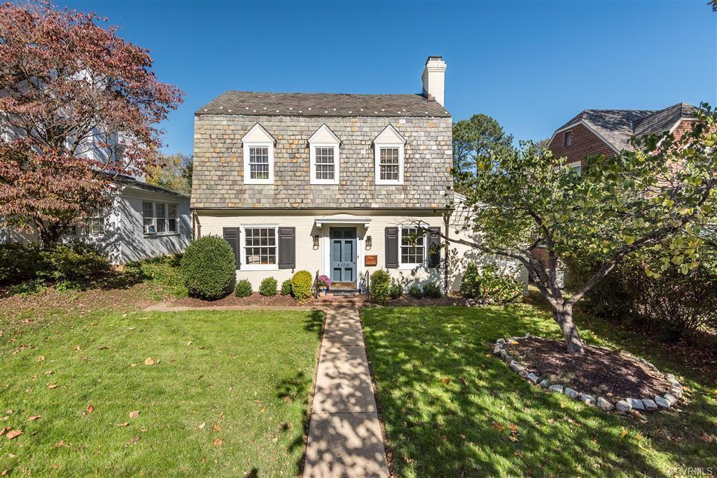 This beautiful brick Dutch colonial with Vermont buckingham slate roof on a coveted block of Hanover