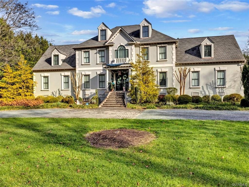 Magnificent custom built home on gorgeous landscaped lot with circular drive.