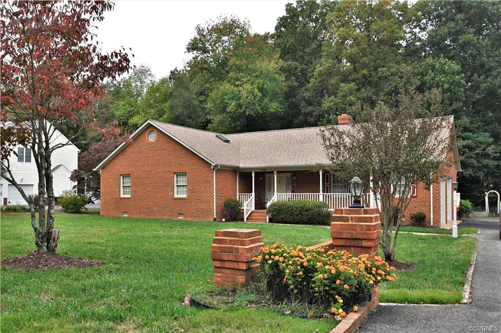 This  lovely home has only had one owner. L Shaped Brick Ranch with a side entry, oversized two car garage! The two doors are above average height. Double wide paved driveway. Great open floor plan with brick wood burning fireplace. Dining room.  Kitchen offers newer dishwasher and microwave. Large Sun Room, 2 1/2 baths, 3 spacious bedrooms. Owners Bedroom offers walk-in cedar lined closet, full bath with oversized jetted tub.  Central Vac, ceiling fans throughout. Newer heat pump (2018), New Roof (2019). Laminate wood grain floors except the 3 carpeted bedrooms. Front Porch. Detached shed for storing all lawn equipment. Super Neighborhood and a very convenient location. Move in Ready! Front Porch and Large Deck.
