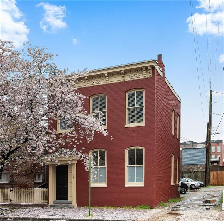 Come see this renovated gem loaded with original charm in Jackson Ward with all that this prime down