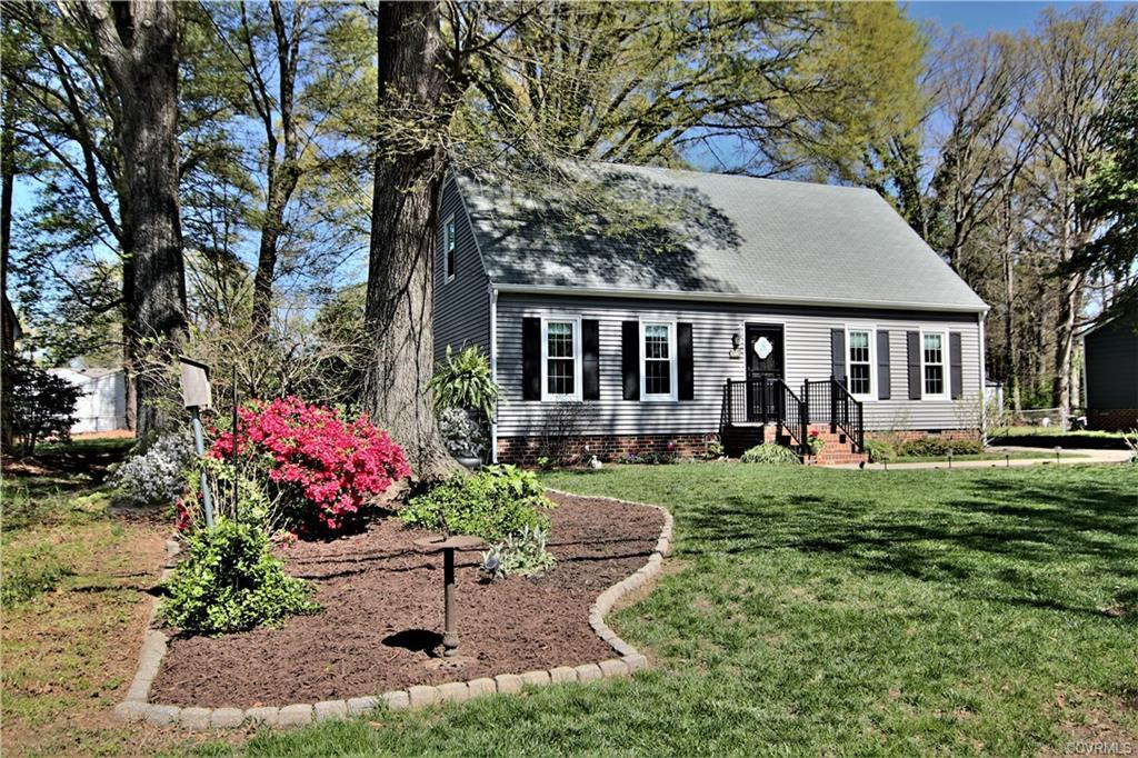 Super cute vinyl sided Cape with a first floor master and a total of four bedrooms and two baths AND