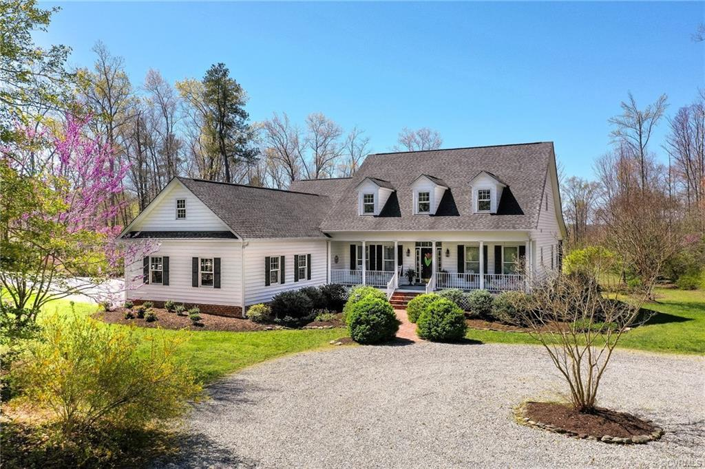 Southern Living at its BEST! Situated beautifully on 10+ Acres, only a mile from everything the Town