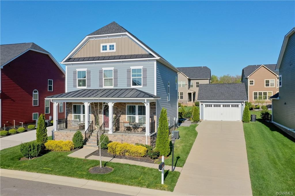 Welcome home!!   This Short Pump STUNNER has all the bells and whistles.   Open floor plan with hardwoods throughout the first floor.  Designer light fixtures, tray ceiling and columns in formal rooms.  Gorgeous kitchen with gas cooking, stainless appliances that convey, breakfast bar, tile back splash, and granite tops.  Second floor has 4 generous sized bedrooms - all with ceiling fans, carpet, and good size closets.  Master suite has tray ceiling, barn doors to luxury bathroom and another set to walk in closet.  The bathroom has adult height double vanity with Quartz top and Roman shower.    There is also a fully finished walk out basement.   Awesome space for recreation and gathering at the built in bar.   Extra room in basement adjacent to full bath could be 5th bedroom (no window so not included in listing bedroom count).   Other features include:   Detached 2 car garage, neighborhood amenities, phenomenal rear yard with hardscaped entertaining area that includes a stone fireplace.   Covered front porch with swing.   Irrigation, sidewalks, concrete driveway, new sump pump, laundry room with washer and dryer that convey.   Association covers lawn care, trash, and snow removal.