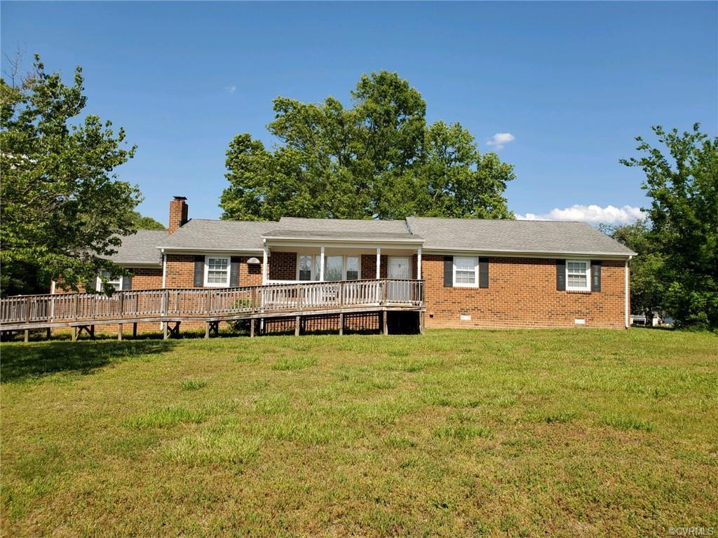 "Unusual find in Mechanicsville! This home is conveniently located on a little over 2 acres.  This is a sturdy brick ranch with three bedrooms, living room, eat in kitchen, and den with a gas burning fireplace.  The home has beautiful hardwood floors in the living room, foyer, hall and bedrooms. There is shadow box molding in the hallway and chair rails in the hallway and living room  This home is equipped with a large handicapped shower and grab bars.  The home also has a nice back porch and large utility room with sink and cabinets.  Additionally, this house has a one car attached garage, detached two car garage, and storage shed.  All appliances will convey as shown in the home.  This home will be sold"" as is where is.""  Inspections will be for informational purposes only.  Owner will provide buyer with an inspection report as well. Backyard is fenced in."