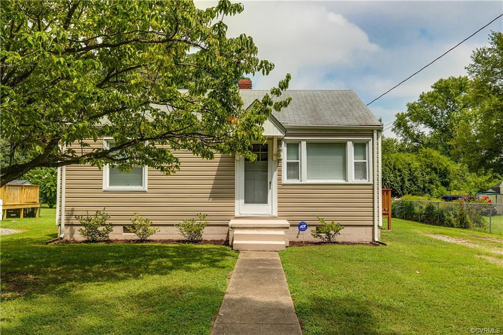 This classic 1950's cottage set on a quarter-acre sized lot in the McGuire Manor neighborhood is mov