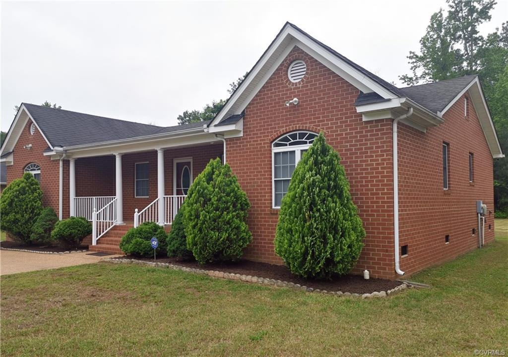 WOW! WOW! WOW! Beautiful, Renovated BRICK Rancher with Hardwood and Tile flooring throughout in a ve