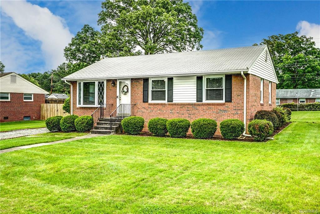 Cute brick rancher in Laurel Park subdivision.  Living room has hardwood floors and bay window.  Kit