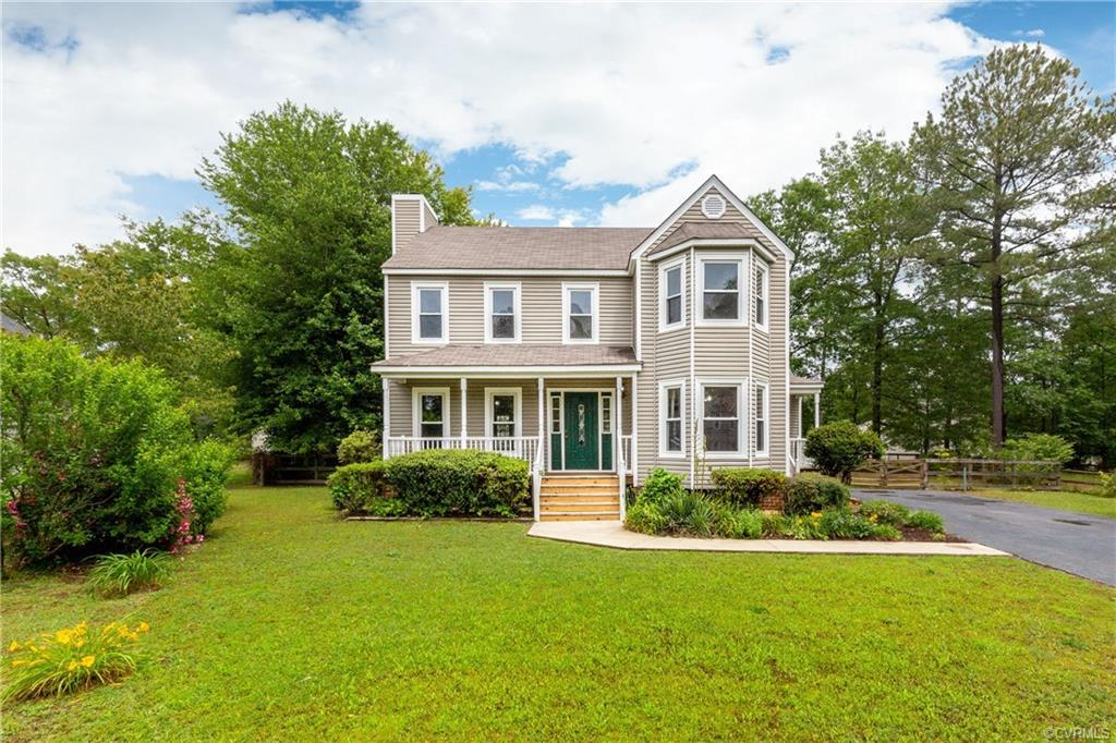Searching for a charming home in an established neighborhood? This well loved, cared for one owner h