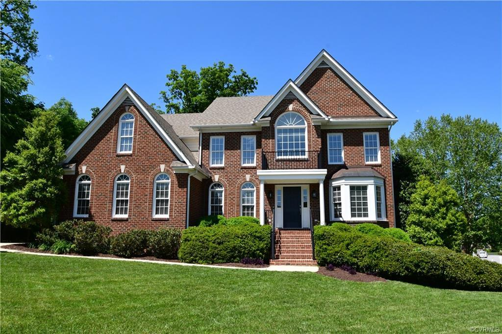 Located in one of the most sought after neighborhoods in Chesterfield County, this elegant 3-story brick front is gorgeous from front to back, even the finished walkout basement with full bath. Totally renovated! Move in ready! Two-story foyer, refinished wood floors throughout first level, living room, dining room with butler's pantry, half bath. Family room with gas fireplace, open to spectacular kitchen with gas cooktop in center island, beautiful new granite countertops, new oven, microwave/convection and dishwasher. Walk in pantry, eat at bar. Morning room with tons of natural sunlight, double doors to new deck that overlooks partially wooded lot. Large room to right of family room can be used as office, den or playroom, Second level offers 5 bedrooms,3 full baths, large master suite with spacious sitting room, walk in closet, luxury master bath with new square porcelain sinks and granite counter. Central Vac. Stairs to  unfinished third floor. Two-car side entry garage and masonry storage under morning room. The recently renovated basement w/Full Bath, could be awesome In -law suite! Walk out to Patio. Expandable 3rd level with sheet rock on site! 14 Rooms including Basement!