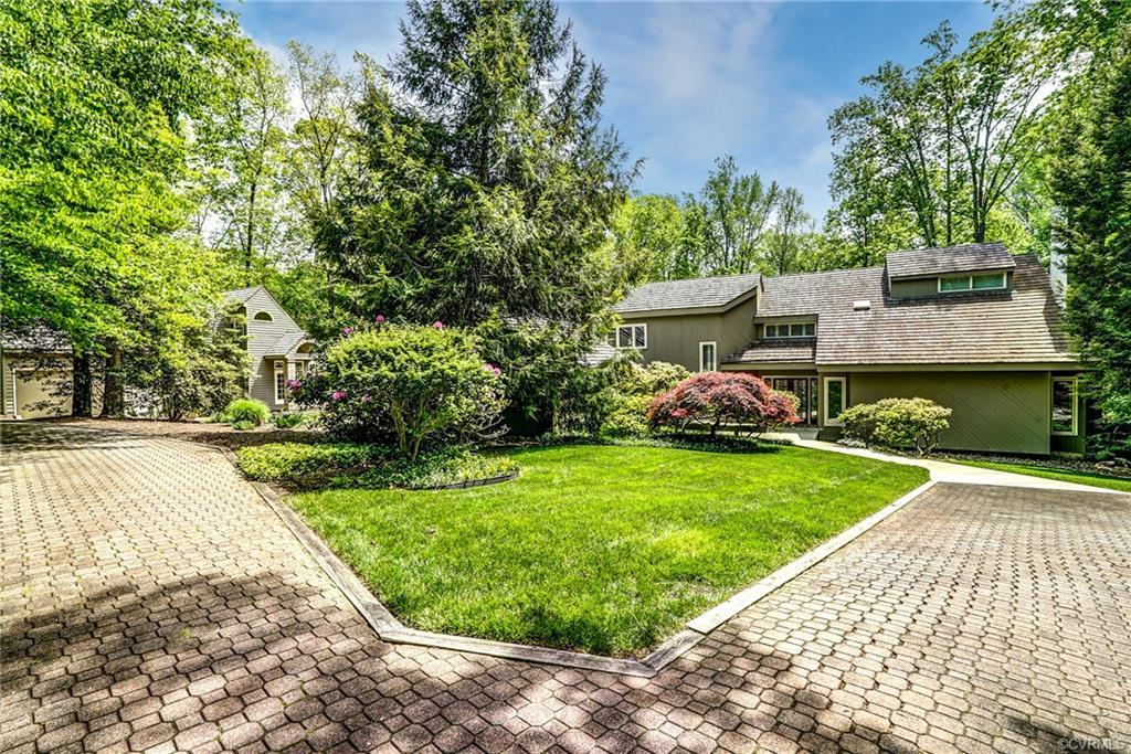 One of a kind Private Oasis nestled on a spectacular 1.6 Acre lot at Hermitage Country Club.  Perfec