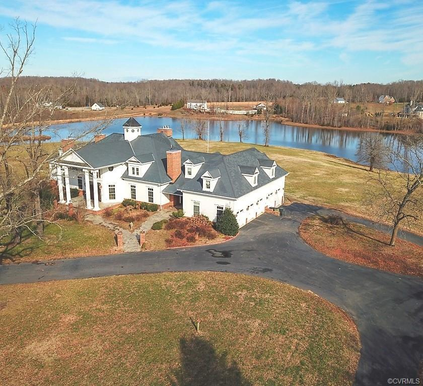 This fine estate consists of a magnificent mansion handsomely sited on 10+ waterfront acres with no