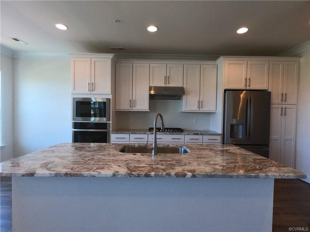 This Monroe Condo is a brand new upper level home in our two-over-two style buildings. Features incl