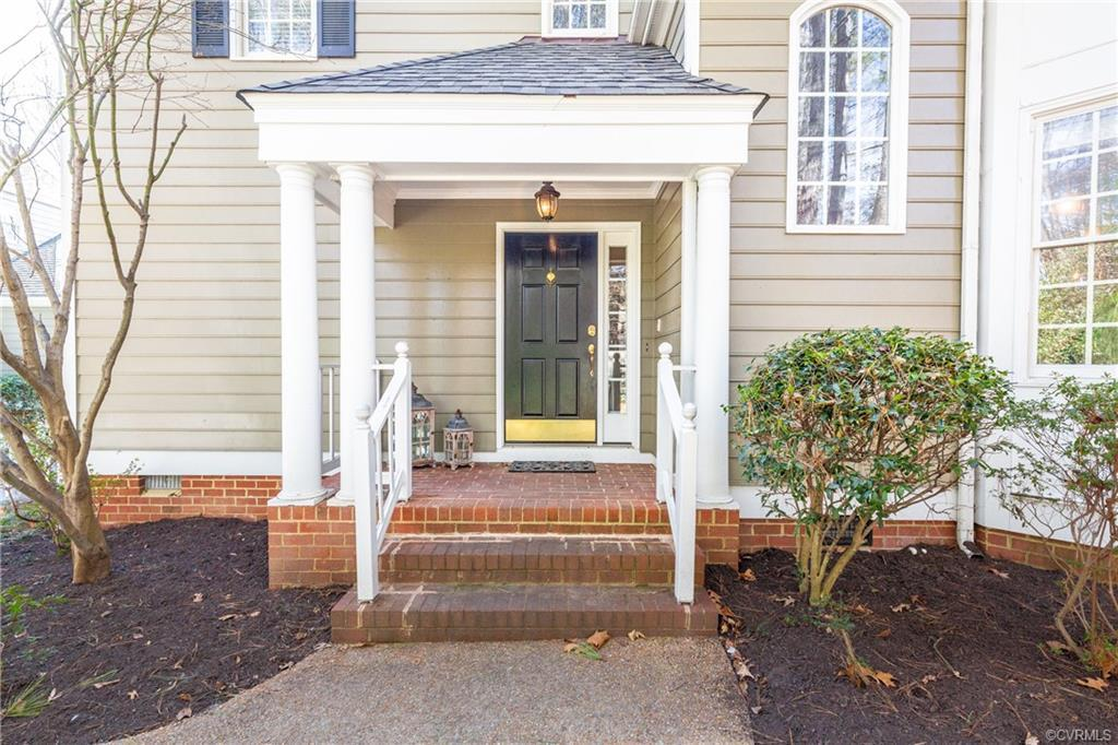 : Love where you live!! Maintenance free with a vacation feel! Detached condo tucked away on a private wooded lot with plenty of parking area and 2 car garage. Phenomenal open floor plan with hardwoods throughout. Two bay windows. Spacious living spaces including family room with gas fireplace, built in bookshelves, and is open to updated and gorgeous white kitchen with stainless appliances, gas cooking, pantry, tons of cabinet and counter space, subway tile backsplash, and granite tops. New fixtures, many rooms freshly painted, double member crown molding, 2 story foyer, french doors, First floor master with large closet and easy access to full bath with shower. Second floor masters has a large walk in closet and a great bath with adult height double vanity and large walk in shower. Laundry / Mud room with washer and dryer that convey and access to garage. Exterior access from kitchen - perfect for groceries. Great private deck off of family room - perfect for entertaining. Other features include: All appliances convey, covered front porch, ample parking areas, attached storage shed, walk to lake, pool access, gym, tennis, basketball, and so many other amenities.