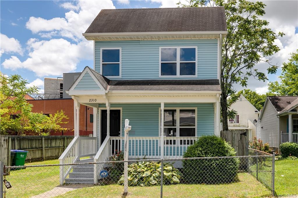Welcome to this charming two-story on a quiet street just minutes from Downtown! Imagine spending an