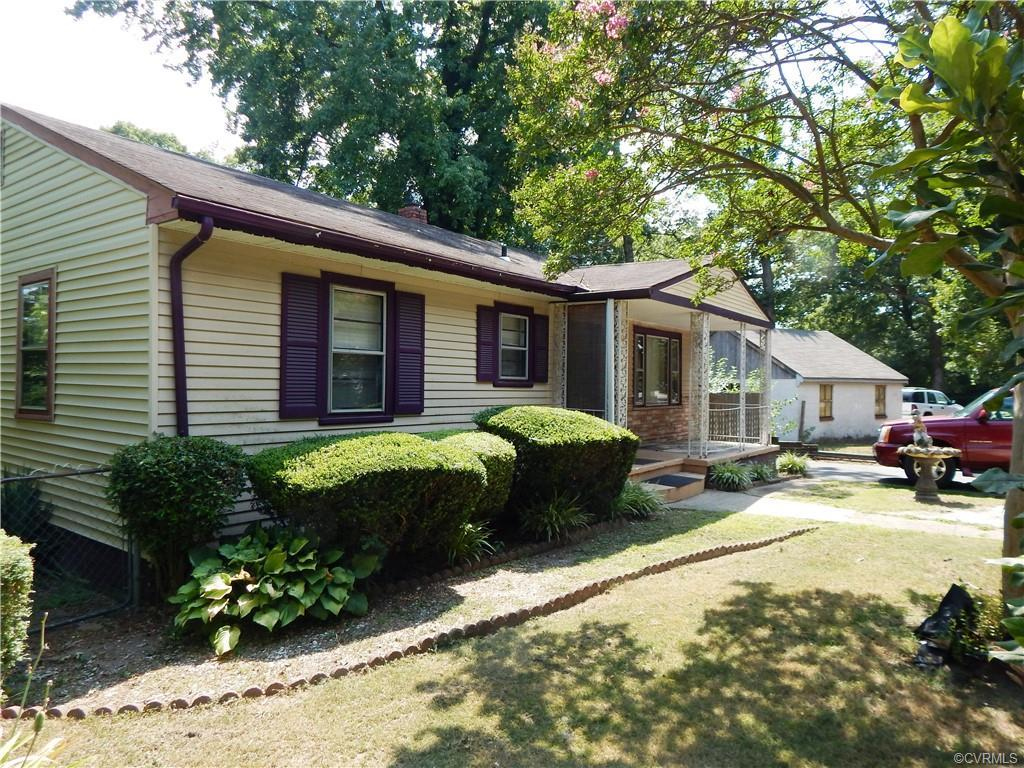 Charming Cottage with inviting front porch has lots of appeal and character!  Spacious living room w