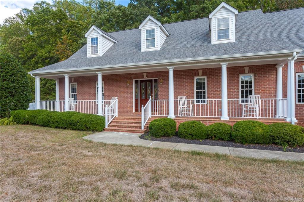 This spacious custom built all brick home with full front porch is situated on 10 beautiful acs in P