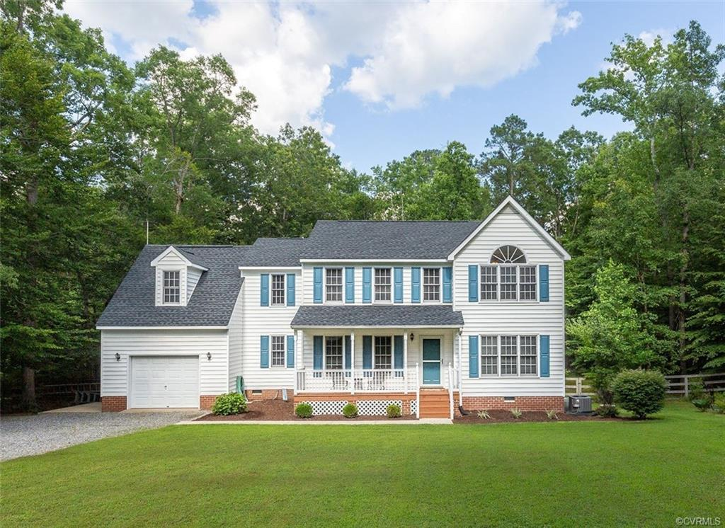 Gorgeous colonial home on a private, scenic lot! This large well kept home features 4 spacious bedro