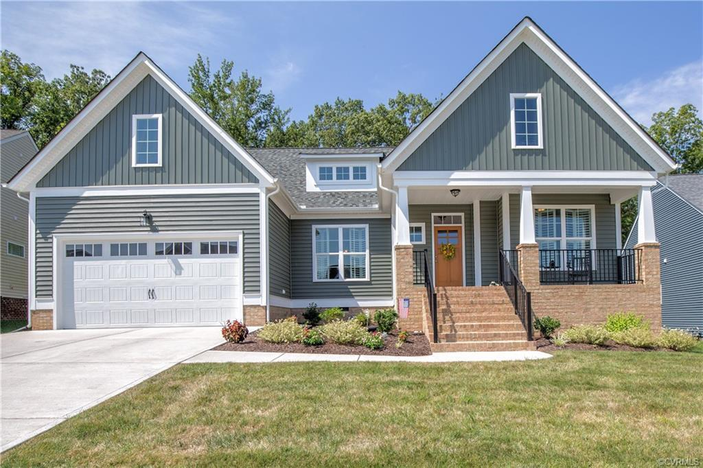 BETTER THAN NEW!!!   Main level living in this Amelia plan by Main Street Homes.  Fabulous floor pla