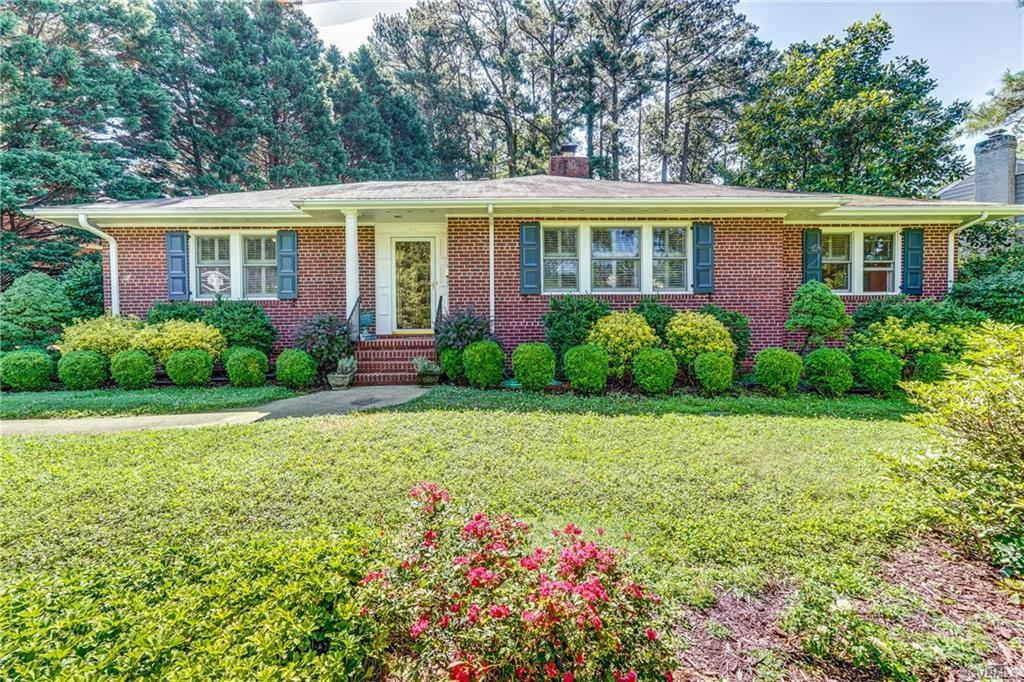 Spacious home nestled in Sunset Hills featuring all brick constructions, first-floor living, beautif