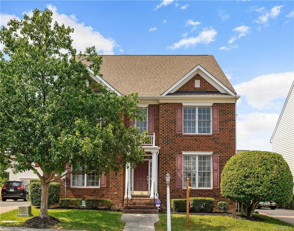 Easy and beautiful landscaping give this brick-front home awesome curb appeal! An open floor plan is