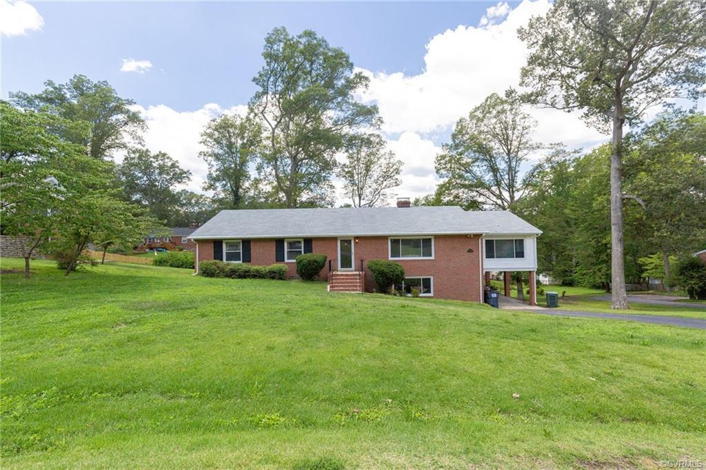 Wow! Don't Miss this Meticulously Maintained Brick Rancher with BASEMENT on nearly 1/2 an Acre!! Wal