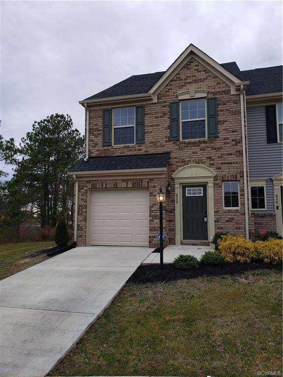 Waterfront End Unit Townhome w/Garage! This almost new 3 bedroom 2.5 bath home offers a brick front