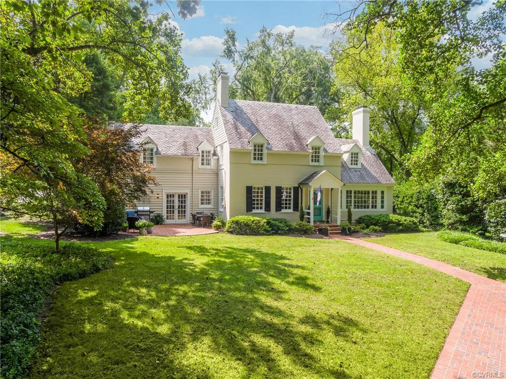 Sited on a private, maturely landscaped lot close to the James River on one of Richmond's mos