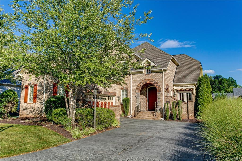 """PRICE REDUCTION! Pristine, open, spacious European inspired home featuring stone & brick front elevation w custom 8' front door & ready to MOVE IN! Foyer opens to sweeping staircase &  formal dining area w/French doors to private walled terrace. Family room boasts a vaulted ceiling w/wall of windows, gas fp & open to kitchen w/eat-in area & doors to 12'7""""x 9'5"""" screen porch w/additional 15'9""""x 14' composite core deck.  Kitchen has custom cabinetry, granite counters, breakfast bar, pantry & stainless steel appliances. Master retreat includes separate sitting area, large walk-in closet & spa bath w/soaking tub, double vanities & shower.  2nd floor offers 2 suites & loft w/Juliet balcony. Spacious 1,763 sq ft finished walk out basement perfect for IN LAW SUITE w/entertainment area & additional room for hobby room.  Off the basement is a fenced patio area w/private garden.  First floor & basement PAINTED 2020. NEW CARPET July 2020 in master suite & basement.  Other features include wood floors, plantation shutters, security system, 3 walk-in storage areas, LOW MAINTENANCE LIVING w/lawn care, window & gutter cleaning, irrigation & more. You're on vacation every day!"""