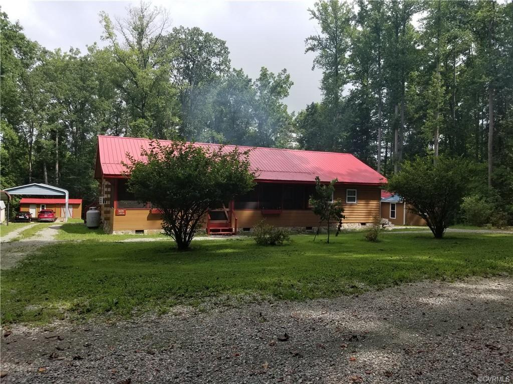 This charming log home is private, but quite elegant as well.  The kitchen features granite counter