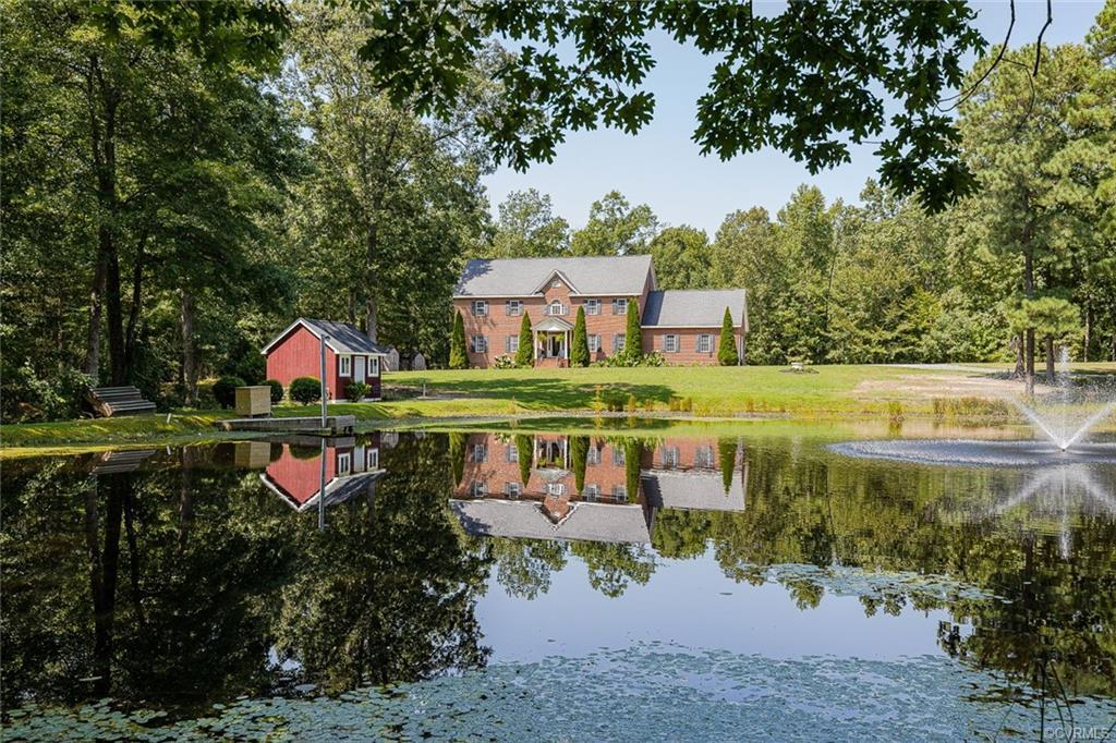 Spectacular ALL brick colonial on 8 private acres (2 parcels) overlooking a pond in close in Glen Al