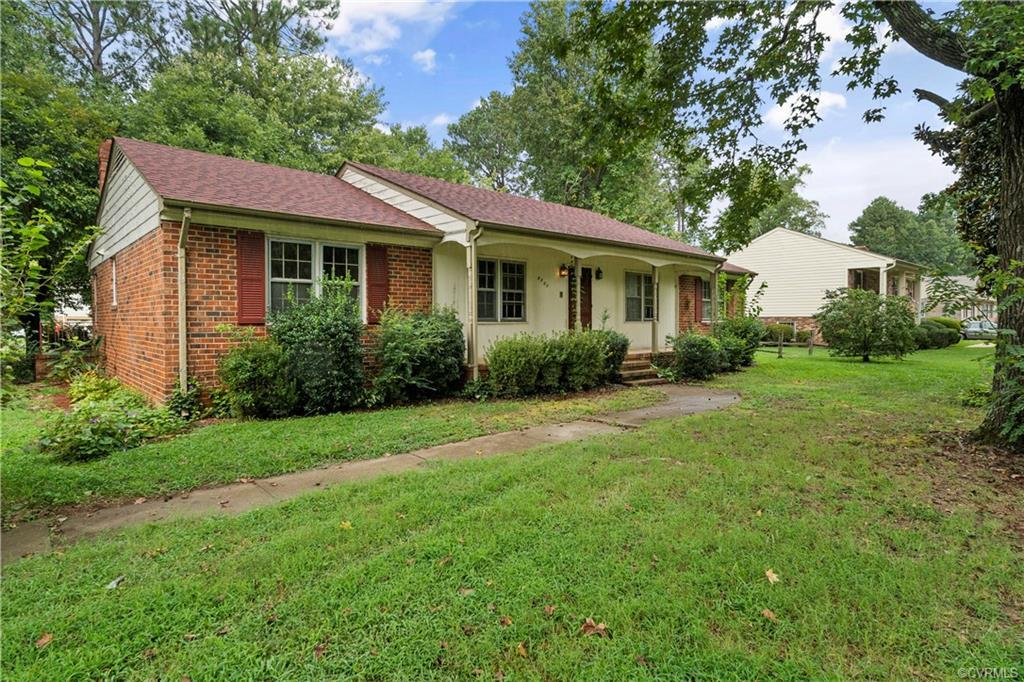 """Welcome to 8300 Chamberlayne Rd in Henrico's centrally located Chamberlayne Farms neighborhood. This all-brick ranch home sits on a large corner lot and is ready for the next owner to renovate to their liking. The single-level layout consists of 3 Bedrooms & 2 Full Bathrooms on 1,800 sqft of living space. The interior is highlighted with hardwood floors, a formal dining room with chair & crown mouldings, formal living room & a family room with a brick wood-burning fireplace. All bedrooms feature hardwood floors, ample closet space & the large master bedroom has an esuite bathroom with shower. The exterior of the home features mature plantings. a flat front lawn, paved loop driveway & detached shed or lawn/garden/storage. This home is ready for renovations and is perfect the buyer looking for sweat equity. Centrally located to all major roads/interstates and just a short drive to downtown RVA. This is an """"AS IS"""" sale."""