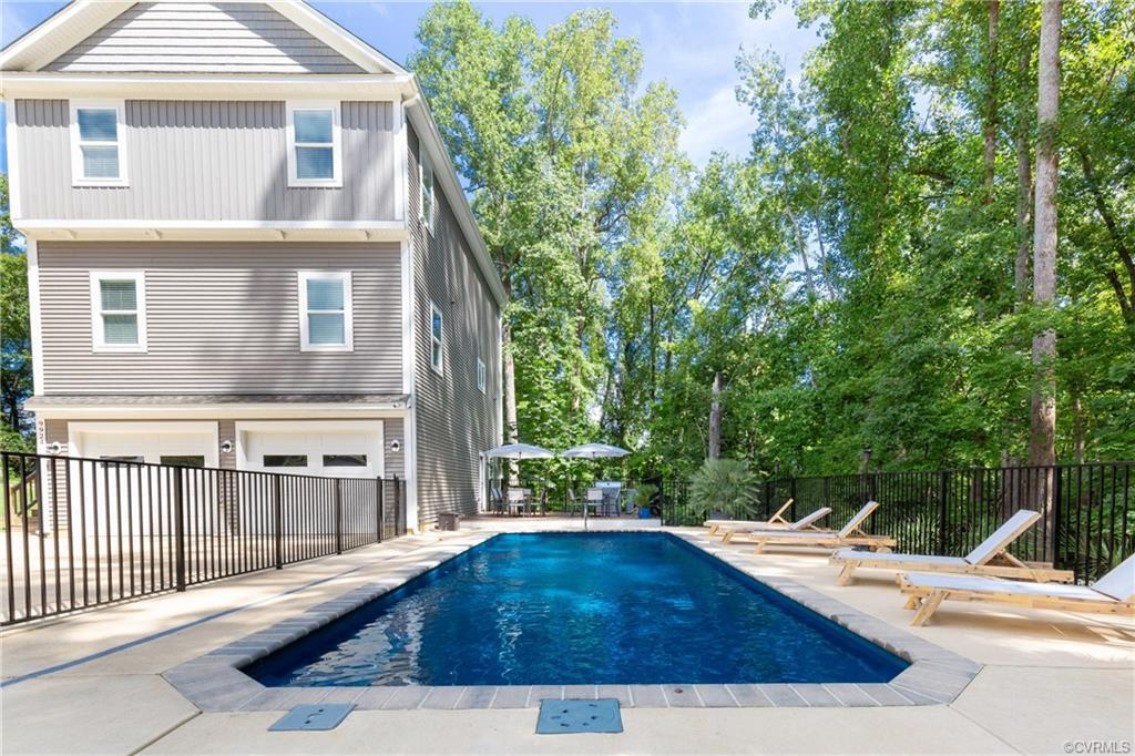 Exquisite Custom Built home with access to the York River.   Easy commute to shopping and dining, also no more than an hour from Richmond - make this little piece of Heaven your Primary home or your getaway!  Live and entertain in luxury!  Relax by the 15'x35' heated salt water pool.  Have your guests stay in the pool studio suite that is equipped with a kitchenette, full bath living and dining area, walk in closet, and bed!  Walk to the secret little beach on the York River.   Masterfully constructed home with modern sleek design and finishes that include custom cabinetry by Old Dominion Cabinets, top of the line fixtures and appliances, Quartz tops in kitchens and all baths, craftsman style trim, solid wood doors, 2x6 walls, beautiful tile work, hardwood floors throughout main home.   Stunning open concept floor plan with a flow that is perfect for entertaining or just enjoying each other.   Grand island in kitchen is the hub of the home with seating and storage for gathering.   Large closets, pull down attic, walk in pantry all make storage a breeze.   Third level houses 3 bedrooms,  laundry, and 2 full baths.   This home is less than 2 years old and will convey furnished.