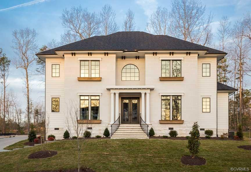Welcome to Perkinson Homes The Alessi. Entering the home you are greeted by a beautiful two story fo