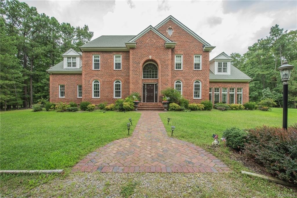 Very own private lot 15.99 ACRES! ALL BRICK custom built home, wooded, circular driveway. House has