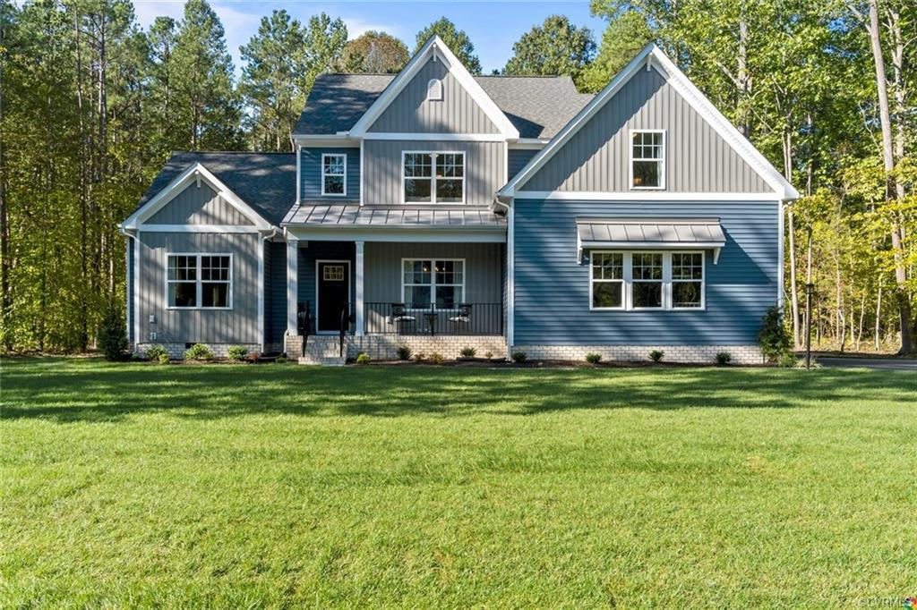 Meet the Hanover with farmhouse elevation and full front porch on 1.48 acres. The Hanover offers amp