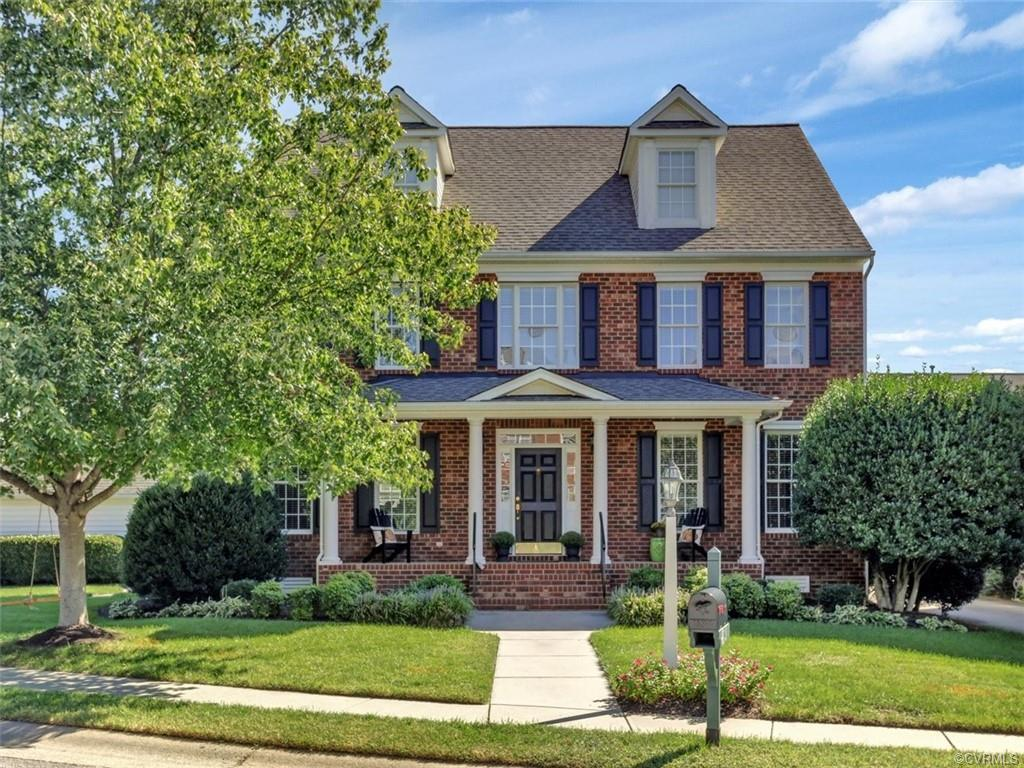 Exquisite custom-built brick front traditional home w/ finished 3rd floor, 2 car garage, & numerous