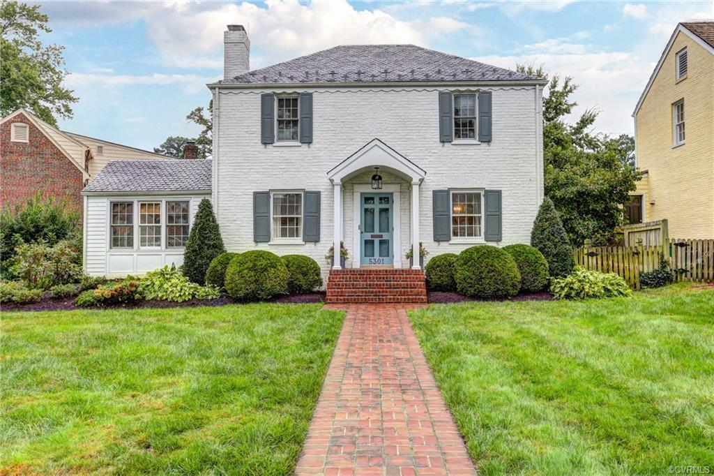 Wonderful white brick and slate home in sought after Glenburnie! Corner lot with large front yard an