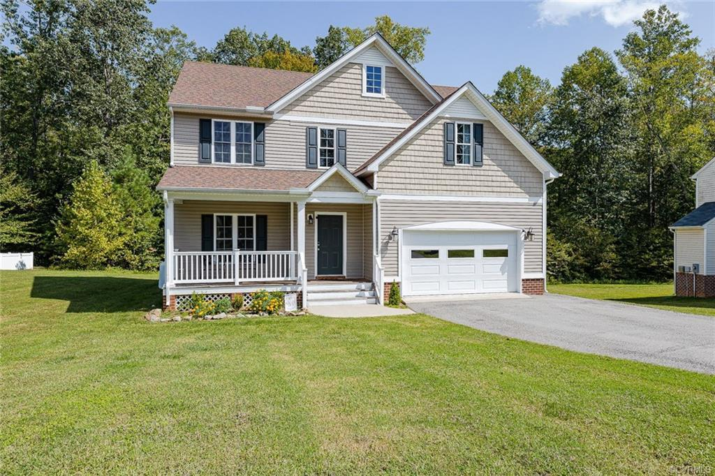This Home has approximately  2000 sf & Sits on Over 1/2 Acre Lot. Foyer, dining room and family room