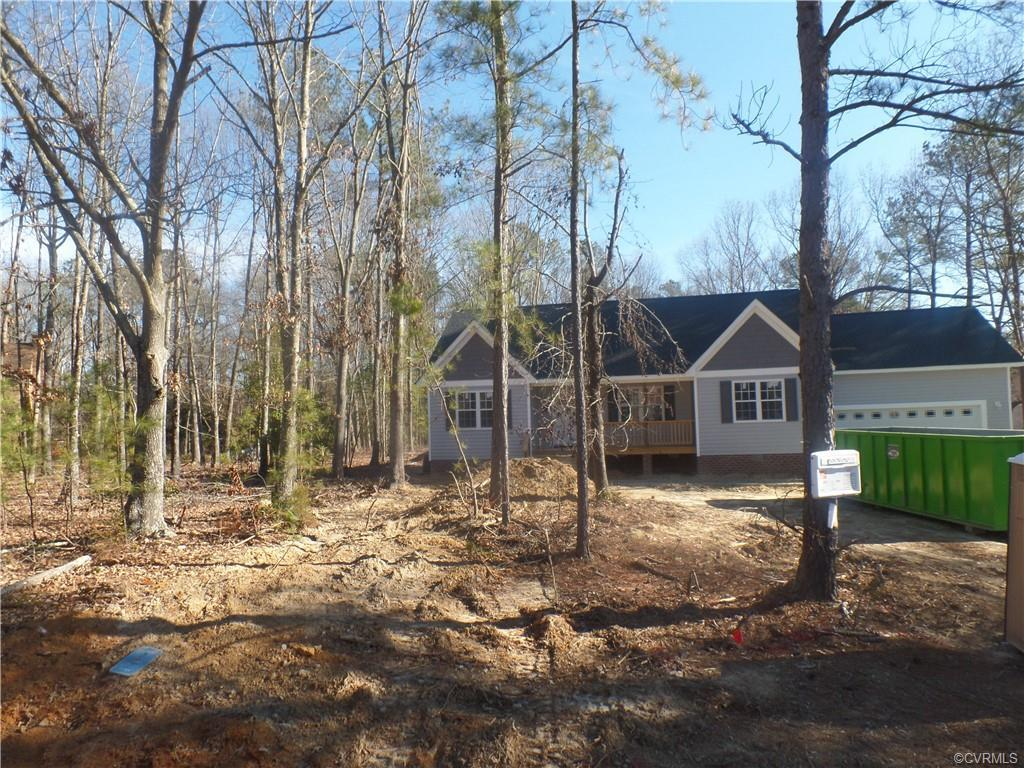 New construction in Matoaca. Split floor plan rancher with cathedral ceiling, granite counter tops,