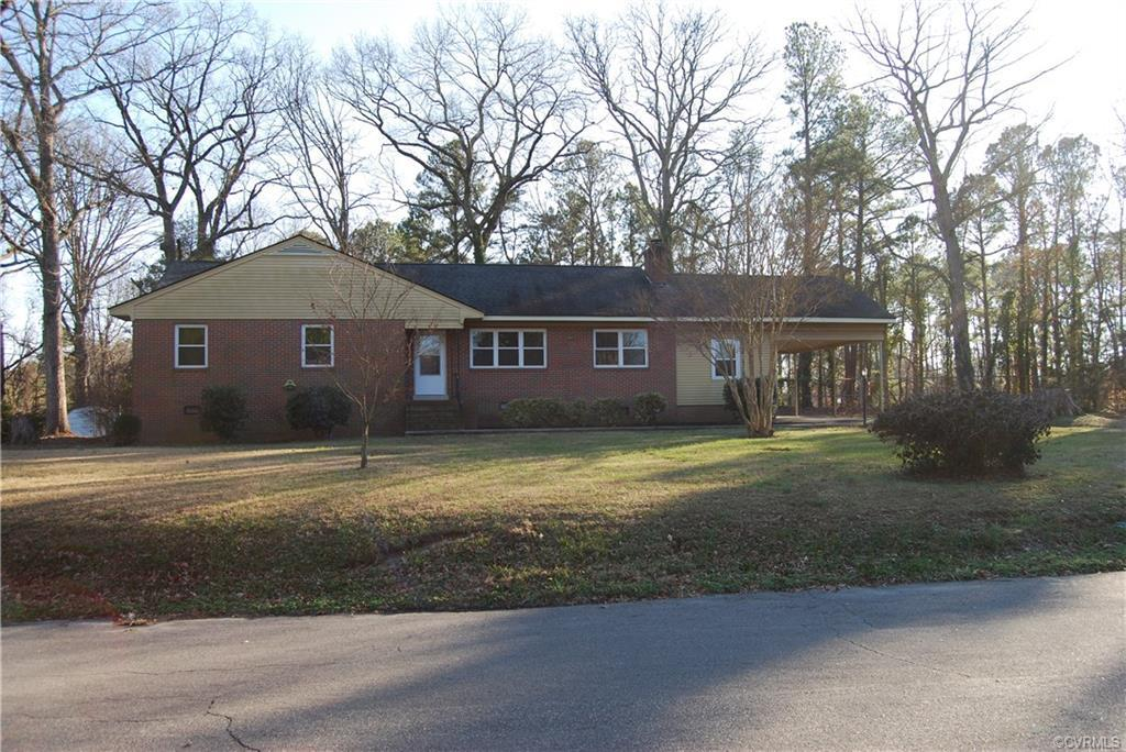 Brick ranch style home featuring 3 bedrooms and 1.5 bathrooms,  1932 square feet and covered carport